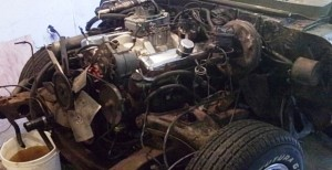 Pontiac Firebird 1968 engine compartment with radiator removed for engine removal.
