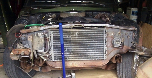 1968 Pontiact Firebird's front bumper removed to get the engine off.
