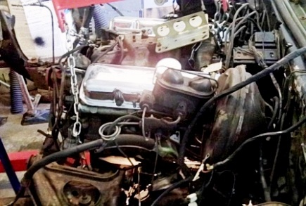 Lifting 1968 Firebird engine with manifold lift.